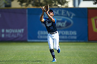 Martinsville Mustangs right fielder Justin Rodriguez (20) (North Carolina A&T) tracks a fly ball during the game against the High Point-Thomasville HiToms at Finch Field on July 26, 2020 in Thomasville, NC.  The HiToms defeated the Mustangs 8-5. (Brian Westerholt/Four Seam Images)