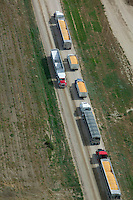 aerial photograph trucks delivering corn cattle feedlot Nebraska