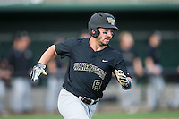 Joey Rodriguez (8) of the Wake Forest Demon Deacons hustles down the first base line against the Charlotte 49ers at Hayes Stadium on March 16, 2016 in Charlotte, North Carolina.  The 49ers defeated the Demon Deacons 7-6.  (Brian Westerholt/Four Seam Images)