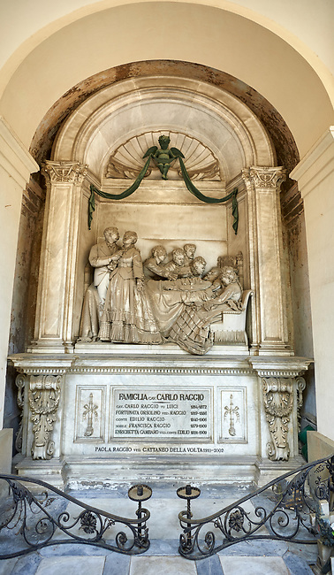 Picture and image of the stone sculpture of a grieving family arounf the death bed of an old man sculpted in Borgeoise Realistic style by A Rivalta in 1872.  The Raggio family tomb, Scection D no 10, the monumental tombs of the Staglieno Monumental Cemetery, Genoa, Italy