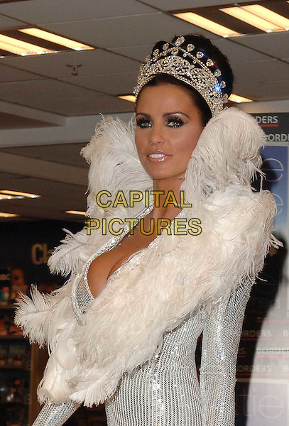 """JORDAN - KATIE PRICE .Launches her new book """"Angel Uncovered"""" at Borders book store, London, England. .July 17th, 2008 .half length silver sequins sequined white feathers feathered collar jewel encrusted crown plunging neckline cleavage bra .CAP/DS.©Dudley Smith/Capital Pictures"""