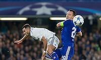 John Terry of Chelsea beats Junior Moraes of Dynamo Kiev (Dynamo Kyiv) in the air during the UEFA Champions League Group G match between Chelsea and Dynamo Kyiv at Stamford Bridge, London, England on 4 November 2015. Photo by Andy Rowland.