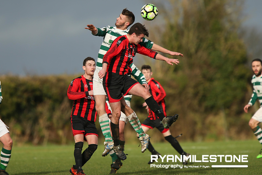 Jamie Kelly of Nenagh in action against Peake Villa's Anthony Walker during the Munster Junior Cup 4th Round at Tower Grounds, Thurles, Co Tipperary on Sunday 28th January 2018, Photo By: Michael P Ryan