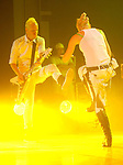 Guitarist Tom Dumont and singer Gwen Stefani of No Doubt perform at the Cynthia Woods Mitchell Pavillion Sunday May 31,2009.(Dave Rossman/For the Chronicle)