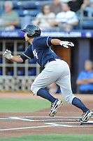 Empire State Yankees left fielder Kevin Russo #7 runs to first during a game against the Durham Bulls at Durham Bulls Athletic Park on June 8, 2012 in Durham, North Carolina . The Yankees defeated the Bulls 3-1. (Tony Farlow/Four Seam Images).
