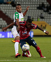 MANIZALES - COLOMBIA - 07 - 03 - 2018: Sergio Lopez (Izq.) jugador de Once Caldas, disputa el balón con Yairo Moreno (Der.) jugador de Deportivo Independiente Medellin, durante partido entre Once Caldas y Deportivo Independiente Medellin, de la fecha 7 por la Liga de Aguila I 2018 en el estadio Palogrande en la ciudad de Manizales. / Sergio Lopez (L) player of Once Caldas, figths the ball with Yairo Moreno (R) player of Deportivo Independiente Medellin, during a match between Once Caldas and Deportivo Independiente Medellin, of the 7th date  for the Liga de Aguila I 2018 at the Palogrande stadium in Manizales city. Photo: VizzorImage  / Santiago Osorio / Cont.