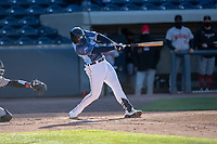 West Michigan Whitecaps third baseman Spencer Torkelson (8) swings the bat against the Great Lakes Loons at LMCU Ballpark on May 11, 2021 in Comstock Park, Michigan. The Loons defeated the Whitecaps in their home opener 9-1. (Andrew Woolley/Four Seam Images)