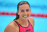 August 01, 2012..Rebecca Soni smiles at the fans as she leaves the pool after competing in Women's 200m Butterfly Semifinal at the Aquatics Center on day five of 2012 Olympic Games in London, United Kingdom.