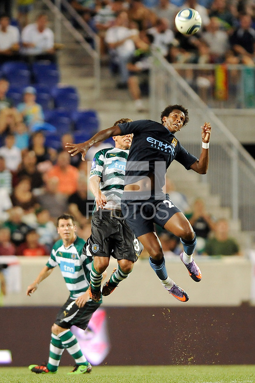 Jo Silva (27) of Manchester City F. C. goes up for a header. Sporting Clube de Portugal defeated Manchester City F. C. 2-0 during a Barclays New York Challenge match at Red Bull Arena in Harrison, NJ, on July 23, 2010.