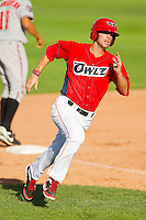 Jarrod Parks (9) of the Orem Owlz rounds third base on his way to scoring a run against the Billings Mustangs at Brent Brown Ballpark on July 22, 2012 in Orem, Utah.  The Mustangs defeated the Owlz 13-8.  (Brian Westerholt/Four Seam Images)