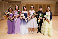 Performers pose for a group photo after the Stars of Tomorrow Concert at the 11th USA International Harp Competition at Indiana University in Bloomington, Indiana on Thursday, July 11, 2019. Pictured from left are: Renee Murphy, Hanjiao Zou, Yuet Kan, Valerie Sim, Xinyue Zhang and Annette Lee. (Photo by James Brosher)