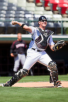 Catcher Tyler Flowers #17 of the Charlotte Knights makes a throw to first base on a dropped third strike during an exhibition game against the Kannapolis Intimidators at Knights Stadium on April 3, 2011 in Fort Mill, South Carolina.    Photo by Brian Westerholt / Four Seam Images