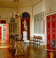 In the dining room the table and fine gilt-bronze oil chandelier are both by Karl Friedrich Schinkel
