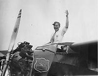 Eddie August Schneider (1911-1940) waving on August 24, 1930 .