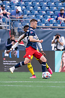 FOXBOROUGH, MA - MAY 16: Amor Traustason #25 of New England Revolution passes the ball towards the Columbus SC goal during a game between Columbus SC and New England Revolution at Gillette Stadium on May 16, 2021 in Foxborough, Massachusetts.