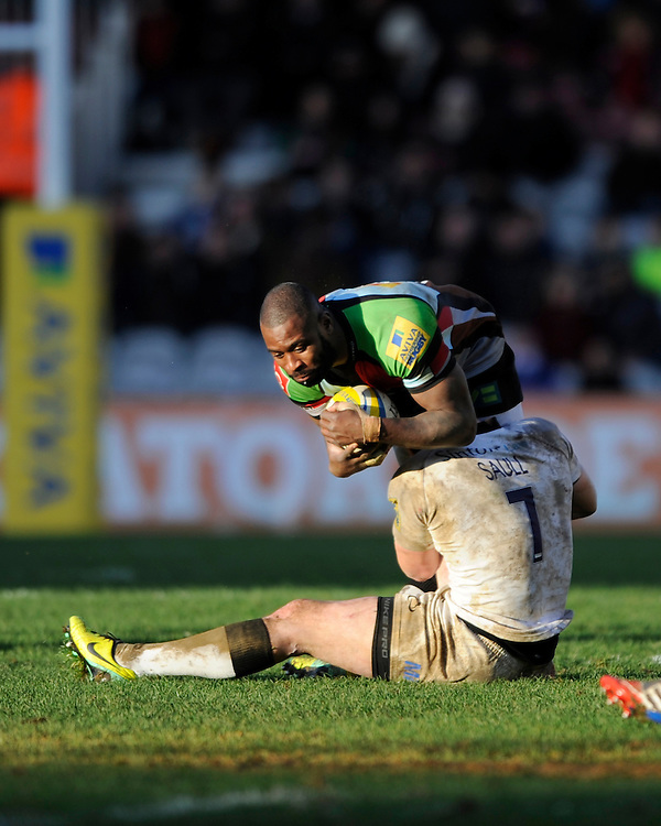 Ugo Monye of Harlequins is tackled by Andy Saull of Newcastle Falcons during the Aviva Premiership match between Harlequins and Newcastle Falcons at the Twickenham Stoop on Saturday 15th February 2014 (Photo by Rob Munro)