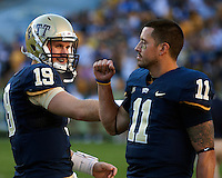 Pittsburgh quarterbacks Pat Bostick (19) and Bill Stull (11) have a playful  exchange before the game. The Pittsburgh Panthers defeated the Navy Midshipmen 27-14 at Heinz Field, Pittsburgh, PA.