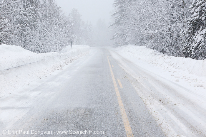 Kancamagus Scenic Byway in the White Mountains, New Hampshire USA during a winter snow storm.