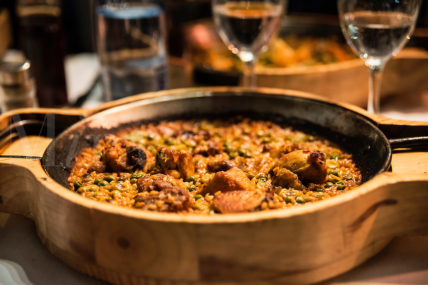 Paella with chicken served in a restaurant, Barcelona, Spain