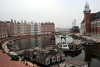 Dutch style town houses curve around a central canal full of rotting house boats in Holland Village, a 600 acre re-creation of a Dutch city on the outskirts of Shenyang lies in ruins as a monument to corruption in China. Yang, a Dutch passport, got hooked on Holland while studying horticulture at Leiden University. Yang, who built the village with some of ill gotten millions, now languishes in jail and the town that is composed of several monumental buildings, plus windmills, artificial lakes, canals, a fullsize sailing ship, 1400 luxury apartments and even an indoor beach.