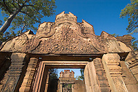 East Gopura of Banteay Srei with bas relief in red sandstone, 10th century Khmer architecture at Angkor Wat -  Siem Reap, Cambodia..