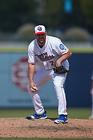 Kannapolis Cannon Ballers relief pitcher Zach Cable (7) looks to his catcher for the sign against the Lynchburg Hillcats at Atrium Health Ballpark on August 29, 2021 in Kannapolis, North Carolina. (Brian Westerholt/Four Seam Images)