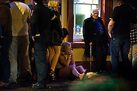 Saturday 21 December 2013<br /> Pictured: A girl sits on the floor in the rain on Lammas Street in Carmarthen, Wales<br /> Re: Black Friday Drinkers