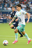 KANSAS CITY, KS - AUGUST 10: Victor Davila #7 Club Leon with the ball during a game between Club Leon and Sporting Kansas City at Children's Mercy Park on August 10, 2021 in Kansas City, Kansas.