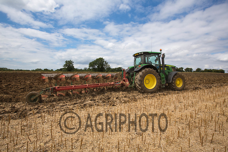 John Deere tractor ploughing rape stubble to help with Blackgrass control in Rutland<br /> Picture Tim Scrivener 07850 303986