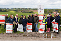 BNPS.co.uk (01202) 558833. <br /> Pic: CorinMesser/BNPS<br /> <br /> Pictured: Protestors gather in front of the view they hope to save. <br /> <br /> Plans to build a huge solar power farm over the landscape that inspired author Thomas Hardy have been met with growing opposition.  <br /> <br /> The industrial-sized plant would see some 150,000 panels cover 190 acres of Dorset countryside.
