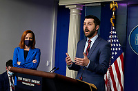 United States National Economic Council Director Brian Deese speaks at a press briefing in the Brady Press Briefing Room of the White House in Washington, DC on April 26, 2021.  White House Press Secretary Jen Psaki looks on from left.<br /> CAP/MPI/RS<br /> ©RS/MPI/Capital Pictures