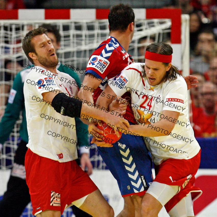 Kasper Nielsen (L) and Mikkel Hansen (R) of Denmark in action during men`s EHF EURO 2012 handball championship final game between Serbia and Denmark in Belgrade, Serbia, Sunday, January 29, 2011.  (photo: Pedja Milosavljevic / thepedja@gmail.com / +381641260959)