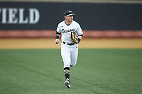 Wake Forest Demon Deacons left fielder Chris Lanzilli (24) jogs off the field between innings of the game against the Sacred Heart Pioneers at David F. Couch Ballpark on February 15, 2019 in  Winston-Salem, North Carolina.  The Demon Deacons defeated the Pioneers 14-1. (Brian Westerholt/Four Seam Images)