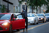 A man steps from his vehicle to express support for protestors in Washington, D.C., U.S., on Sunday, May 31, 2020, following the death of an unarmed black man at the hands of Minnesota police on May 25, 2020.  Credit: Stefani Reynolds / CNP/AdMedia