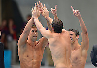 August 04, 2012..Matt Grevers, Brendan Hansen and Michael Phelps celebrate victory in 4x100m Medley Relay as teammate Nathan Adrian out sprints remaining team to win Gold Medal at the Aquatics Center on day eight of 2012 Olympic Games in London, United Kingdom.