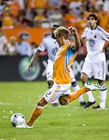 Houston Dynamo midfielder Stuart Holden (22) takes a penalty kick.  Houston Dynamo defeated D.C. United 4-3 at Robertson Stadium in Houston, TX on August 1, 2009.