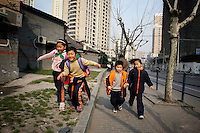 CHINA. Shanghai. Children running down the street. Shanghai is a sprawling metropolis or 15 million people situated in south-east China. It is regarded as the country's showcase in development and modernity in modern China. This rapid development and modernization, never seen before on such a scale has however spawned countless environmental and social problems. 2008.