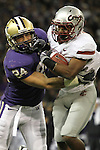 """Carl Winston (#32), Washington State running back and kick returner, is brought down by the UW's Joshua Gage (#24) during the Cougars Pac-10 conference """"Apple Cup"""" showdown with arch-rival Washington at Husky Stadium in Seattle, Washington, on November 28, 2009.  The Cougars lost to the Huskies in the game, 30-0."""