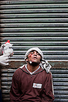 An anti-government protester is treated for injuries sustained in violent clashes with pro-Mubarak supporters in a mosque that is acting as an emergency hospital just off Tahrir Square. Continued anti-government protests take place in Cairo calling for President Mubarak to stand down. After dissolving the government, Mubarak still refuses to step down from power.