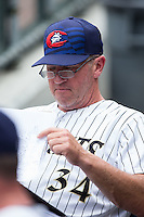 Charlotte Knights pitching coach Richard Dotson (34) looks over his notes during the game against the Gwinnett Braves at BB&T BallPark on July 3, 2015 in Charlotte, North Carolina.  The Braves defeated the Knights 11-4 in game one of a day-night double header.  (Brian Westerholt/Four Seam Images)