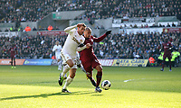 Pictured: Swansea's Angel Rangel and Yoan Gouffran clash on the ball<br />