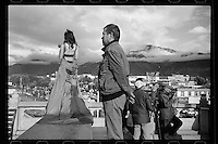 A Chinese woman in evening dress poses for photos outside the Potala Palace in Lhasa, Tibet, September 2016.