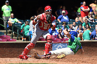 Hagerstown Suns catcher Spencer Kieboom (20) forces out Chad Johnson (7) sliding into home during a game against the Lexington Legends on May 19, 2014 at Whitaker Bank Ballpark in Lexington, Kentucky.  Lexington defeated Hagerstown 10-8.  (Mike Janes/Four Seam Images)