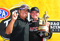 May 6, 2012; Commerce, GA, USA: NHRA top fuel dragster driver Steve Torrence (right) celebrates with father Billy Torrence after winning the Southern Nationals at Atlanta Dragway. Mandatory Credit: Mark J. Rebilas-