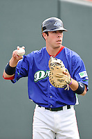 Catcher Austin Rei (13) of the Greenville Drive warms up before a game against the Asheville Tourists on Sunday, April 10, 2016, at Fluor Field at the West End in Greenville, South Carolina. Greenville won 7-4. (Tom Priddy/Four Seam Images)