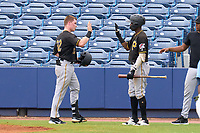 FCL Pirates Black Henry Davis (32) high fives Juan Jerez (38) after hitting a two run home run, the first of his professional career, to opposite field in the top of the fourth inning during a game against the FCL Rays on August 3, 2021 at Charlotte Sports Park in Port Charlotte, Florida.  Davis was making his professional debut after being selected first overall in the MLB Draft out of Louisville by the Pittsburgh Pirates.  (Mike Janes/Four Seam Images)