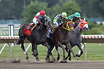 August 2, 2015. Wildcat Red (at center between Stallwalkin' Dude, left, and Deltabluesman), Paco Lopez up, wins the Teddy Drone Stakes, six furlongs for three year olds and upward at Monmouth Park in Oceanport, NJ. Jose Garoffalo trainer; Honors Stable Corp. owner Joan Fairman Kanes/ESW/CSM