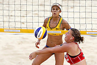 Germany's Britta Buthe, right, in action against Brazil's Talita Antunes <br /> at the Beach Volleyball World Tour Grand Slam, Foro Italico, Rome, 22 June 2013. Brazil defeated Germany 2-1.<br /> UPDATE IMAGES PRESS/Isabella Bonotto