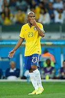 Maicon of Brazil looks dejected