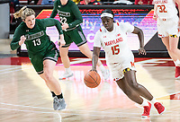 COLLEGE PARK, MD - DECEMBER 8: Ashley Owusu #15 of Maryland dribbles away from Isabella Therien #13 of Loyola during a game between Loyola University and University of Maryland at Xfinity Center on December 8, 2019 in College Park, Maryland.
